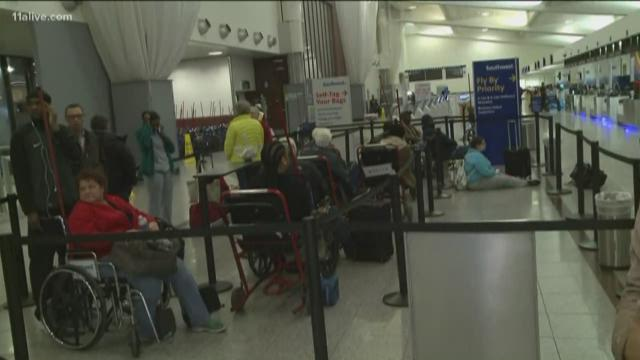 Crowds fill Atlanta's airport the morning after a crippling power outage