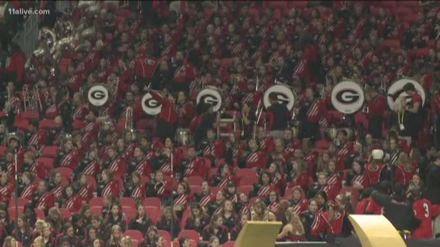 UGA band wears silver ribbon to honor 'Bama band member who died of cancer