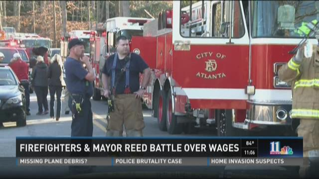 Police, firefighters battle Mayor Reed over wages