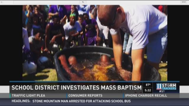 Debate: School district investigates mass baptism